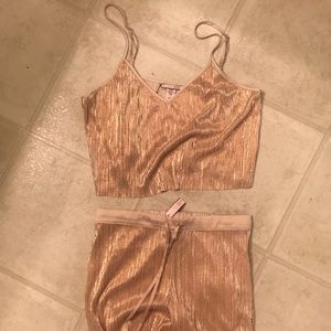 Rose gold glittery pajama set.